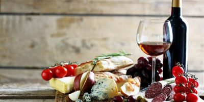 Wine, bread, cheese, sausage, fruit