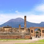 Pompeii ruins with Mt. Vesuvius volcano in background