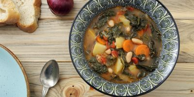 Tuscan Ribollita Soup with spoon and bread